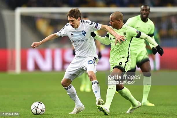 Dynamo Kiev's Ukrainian midfielder Denys Garmash vies with Manchester City's Brazilian midfielder Fernando during the UEFA Champions league round of...