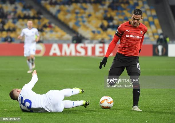 Dynamo Kiev's Ukrainian midfielder Viktor Tsyhankov vies for the ball with Rennes' French forward Hatem Ben Arfa during the UEFA Europa League Group...