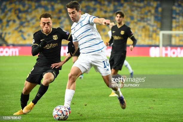 Dynamo Kiev's Uruguayan forward Carlos Maria De Pena Bonino challenges Barcelona's US defender Sergino Dest during the UEFA Champions League group G...
