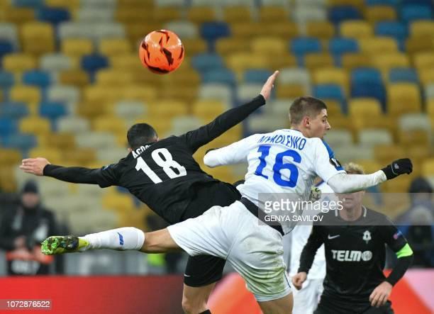 Dynamo Kiev's Vitaliy Mykolenko and Jablonec's Rafael Acosta vie for the ball during the UEFA Europa League Group K football match between Dynamo...