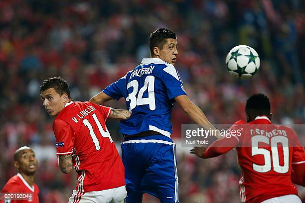 Dynamo Kyiv's defender Evgen Khacheridi heads for the ball with Benfica's defender Victor NilssonLindelof and Benfica's defender Nelson Semedo during...