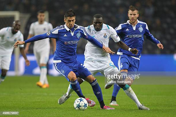 Dynamo Kyiv's defender Yevhen Khacheridi vies with FC Porto's forward Vincent Aboubakar during the Champions League match between FC Porto and FC...
