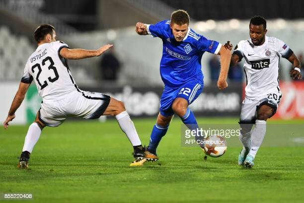 Dynamo Kyiv's forward Artem Kravets vies with Partizan's midfielder Seydouba Soumah and defender Bojan Ostojic during the UEFA Europa League Group B...