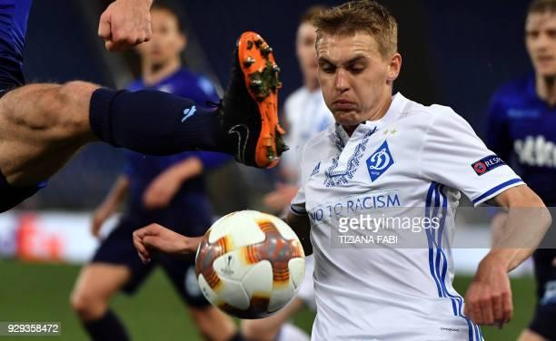 TOPSHOT Dynamo Kyiv's midfielder Vitaliy Buyalskiy eyes the ball during the UEFA Europa League round 16 firstleg football match SS Lazio vs Dynamo...
