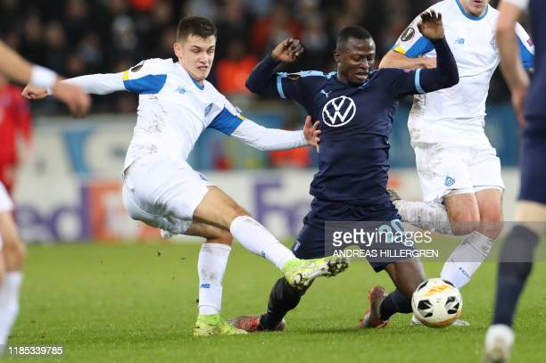 Dynamo Kyiv's Volodymyr Shepeliev and Malmo's Bonke Innocent vie for the ball during the Europa League football match between Malmo FF and Dynamo...
