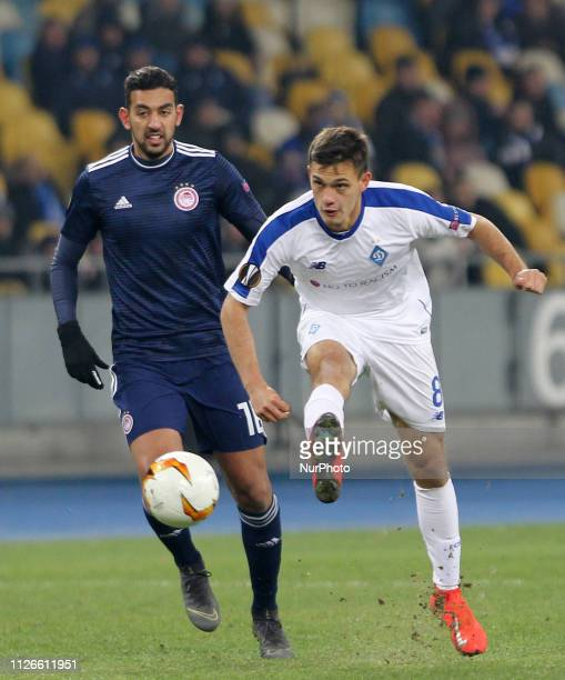 Dynamo Kyiv's Volodymyr Shepeliev fights for the ball with Olympiacos Ahmed Hassan during the UEFA Europa League round of 32 second leg football...