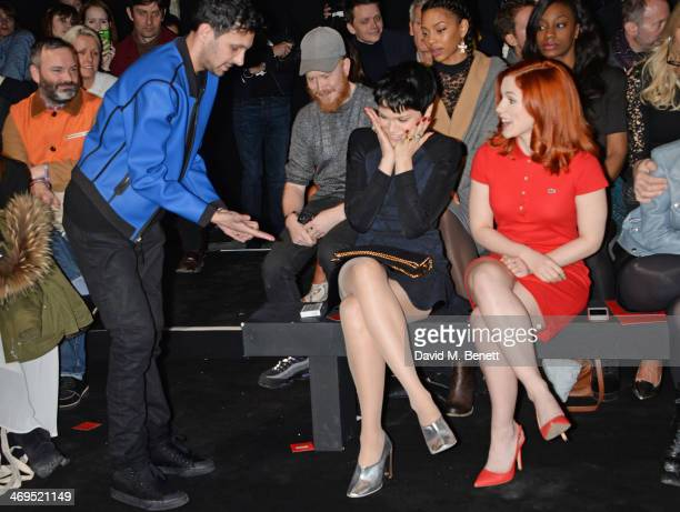 Dynamo performs a magic trick for Jessie J while Katy B looks on at the Hunter Original AW 2014 Show at Ambika P3 Gallery University of Westminster...