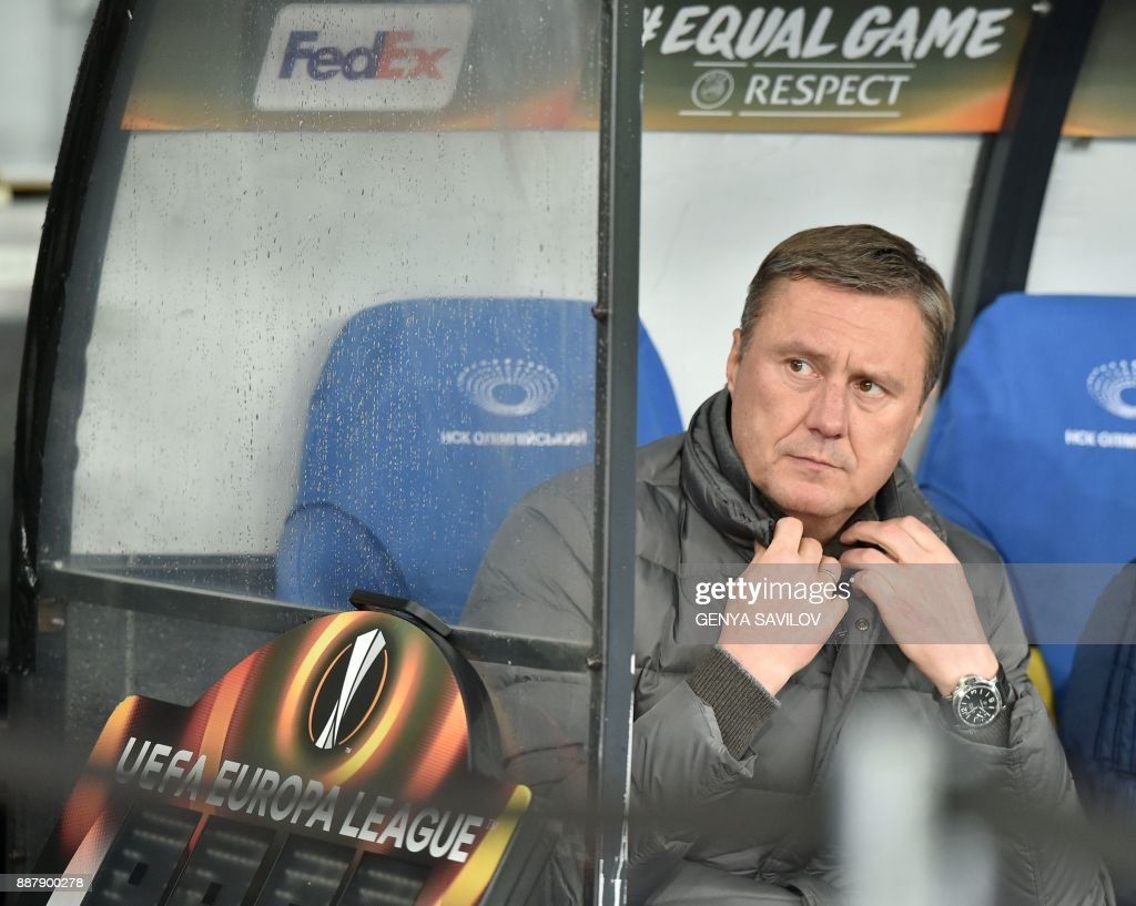 Dynamo's head coach Aleksandr Khatskevich reacts during the UEFA Europa League Group B football match between Dynamo Kiev and Partizan Belgrade on December 7, 2017, at the Olympic Stadium in Kiev. /