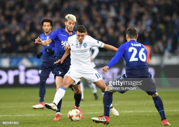 Dynamos Junior Moraes Lazios Stefan Radu and Luis Alberto vie during UEFA Europa League round 16 secondleg football match FC Dynamo Kiev vs SS Lazio...