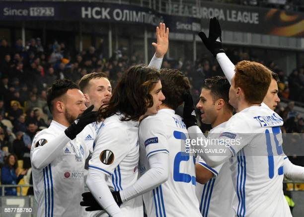 Dynamo's Mykola Morozyuk celebrates with his teammates after scoring during the UEFA Europa League group stage football match between Dynamo Kyiv and...