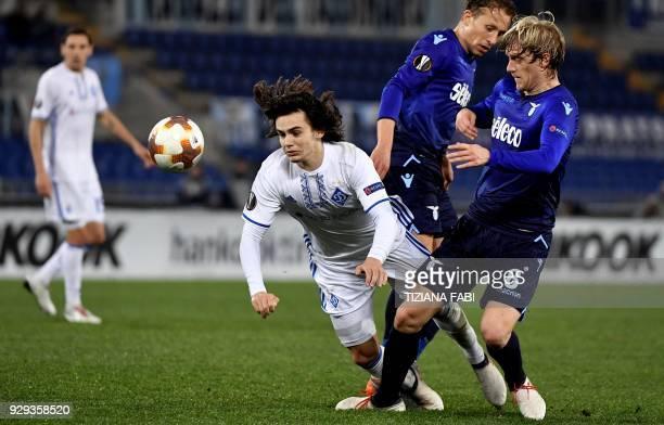 Dynamo's Mykola Shaparenko fights for the ball whith Lazio's defender from Serbia Dusan Basta during the UEFA Europa League round 16 firstleg...