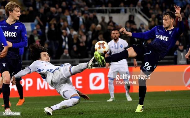 Dynamo's Mykola Shaparenko fights for the ball whith Lazio's midfielder from Italy Alessandro Murgia during the UEFA Europa League round 16 firstleg...