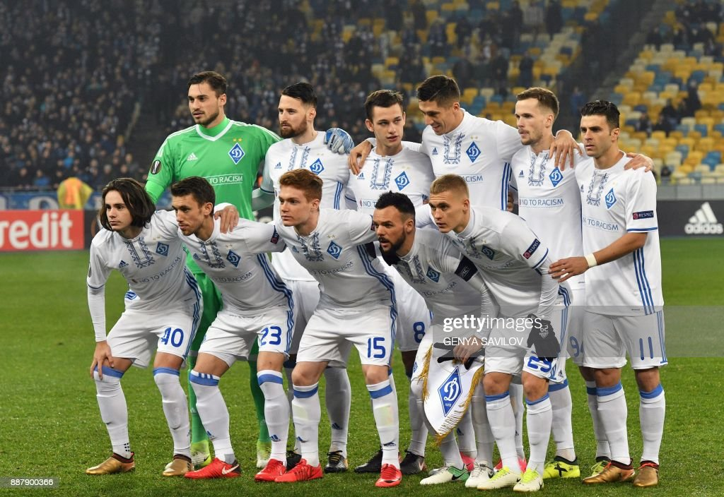 Dynamo's players pose prior to the UEFA Europa League Group B football match between Dynamo Kiev and Partizan Belgrade on December 7, 2017, at the Olympic Stadium in Kiev. /
