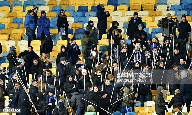 Dynamo's supporters holding sticks prepare to clash with Besiktas' supporters during the UEFA Champions League football match between FC Dynamo Kyiv...