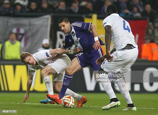 Dynamo's Tomas Hubocan Anderlecht's Alexandar Mitrovic and Dynamo's Christopher Samba fight for the ball during their UEFA Europa League round of 32...