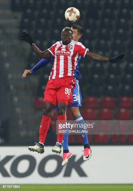 Dynamo's Yevhen Khacheridi fights for the ball with Skenderbeu's Ali Sowe during the UEFA Europa League Group B football match between KF Skenderbeu...