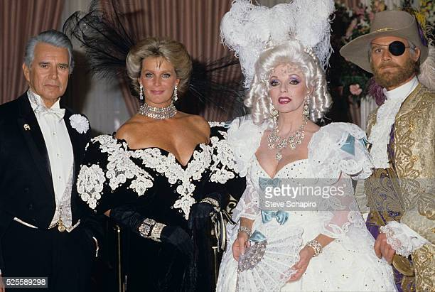 Dynasty cast members John Forsythe Linda Evans Joan Collins and John James in costume
