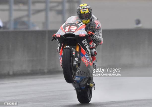 Dynavolt Intact GP rider Thomas Luthi of Switzerland pops a wheelie at the end of the Moto2 third free practice session of Japanese Motorcycle Grand...
