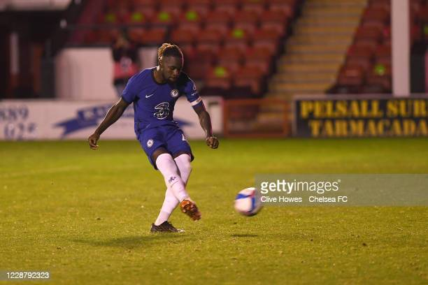 Dynel Simeu of Chelsea takes his penalty in the penalty shootout during the Chelsea Development Squad v Walsall EFL Trophy match at Bank's Stadium on...