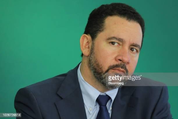 Dyogo Oliveira president of Banco Nacional de Desenvolvimento Economico e Social listens during a news conference at the Planalto Palace in Brasilia...