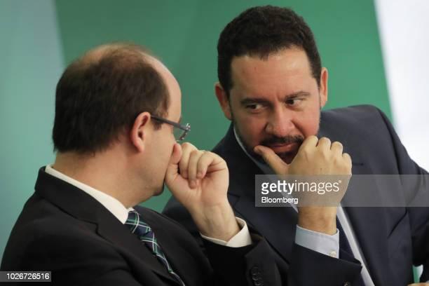 Dyogo Oliveira president of Banco Nacional de Desenvolvimento Economico e Social right speaks with Rossieli Soares da Silva Brazil's minister of...