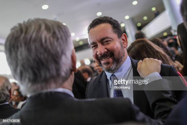 Dyogo Oliveira president of Banco Nacional de Desenvolvimento Economico e Social right speaks with an attendee while exiting from a ceremony for new...