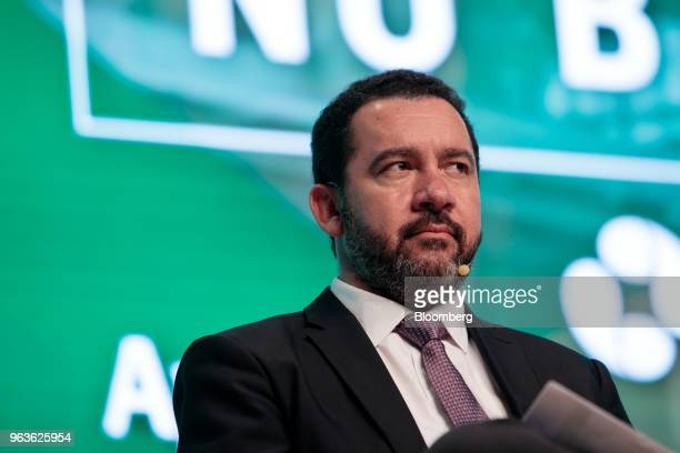 Dyogo Oliveira president of Banco Nacional de Desenvolvimento Economico e Social listens during the Brazil Investment Forum in Sao Paulo Brazil on...