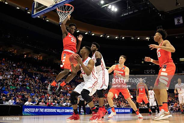 Dyshawn Pierre of the Dayton Flyers drives to the basket against Tyler Roberson of the Syracuse Orange in the second half during the first round of...
