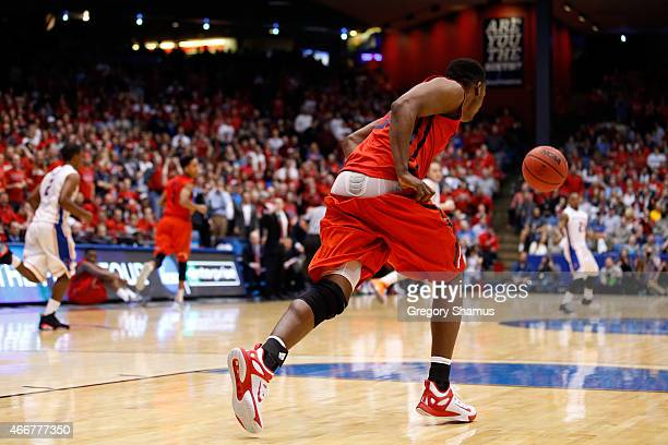 Dyshawn Pierre of the Dayton Flyers pulls up his shorts after they fell down in the second half against the Boise State Broncos during the first...