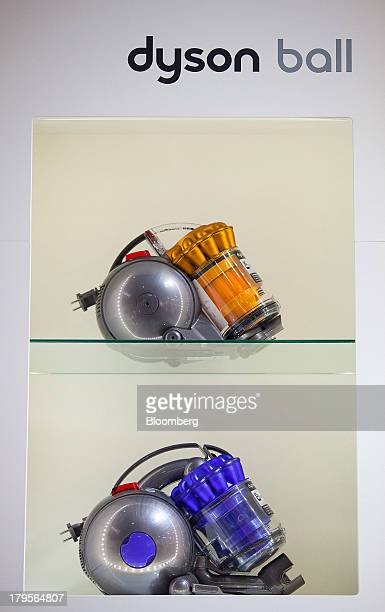 A Dyson Cinetic DC 48 vacuum cleaner sits on a shelf above a Dyson Cinetic DC36 on display during the eve of the opening of the IFA consumer...