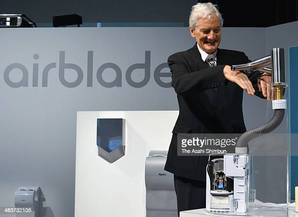 Dyson Company founder and chief engineer James Dyson demonstrates the company's hand dryers during its press preview on April 9 2014 in Tokyo Japan...