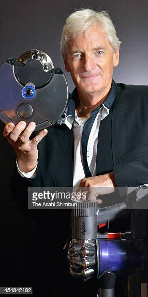 Dyson Company founder and chief engineer James Dyson introduces the 'Dyson 360 Eye' robot vacuum cleaner at its unveiling on September 4 2014 in...