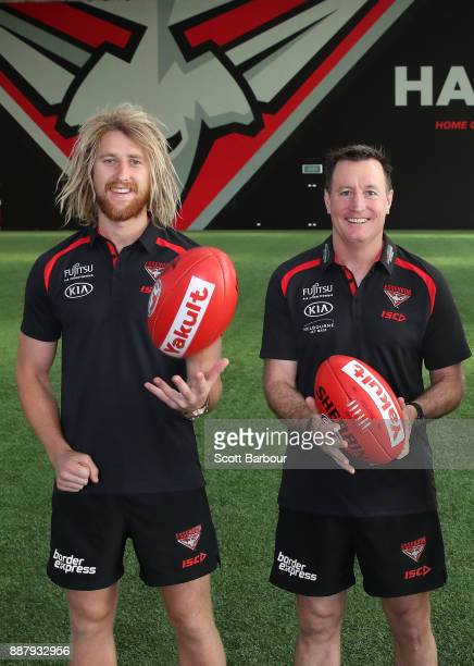 Dyson Heppell and coach John Worsfold pose at 'The Hangar' during an Essendon Bombers Media Announcement Training Session at Essendon Football Club...