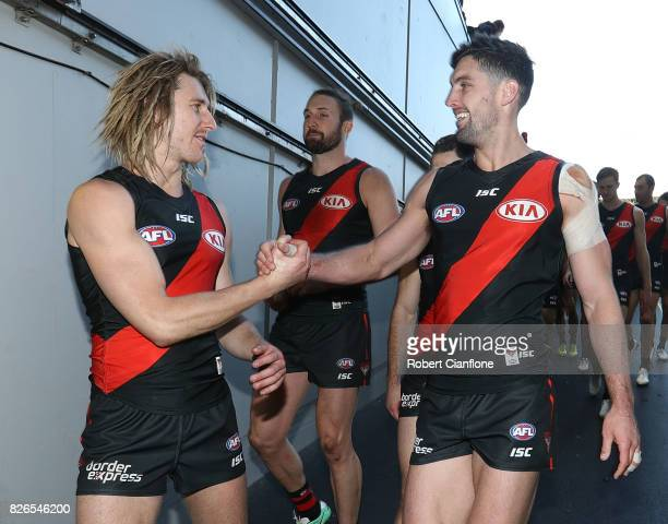 Dyson Heppell and David Myers of the Bombers celebrate after the Bombers defeated the Blues during the round 20 AFL match between the Essendon...