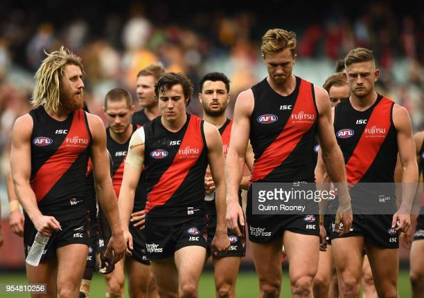 Dyson Heppell and his Bombers team mates look dejected after losing the round seven AFL match between the Essendon Bombers and the Hawthorn Hawks at...