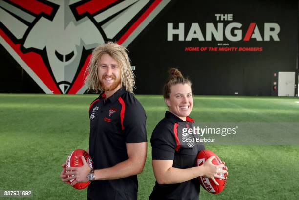 Dyson Heppell and Lauren Morecroft of the Bombers pose at 'The Hangar' during an Essendon Bombers Media Announcement Training Session at Essendon...