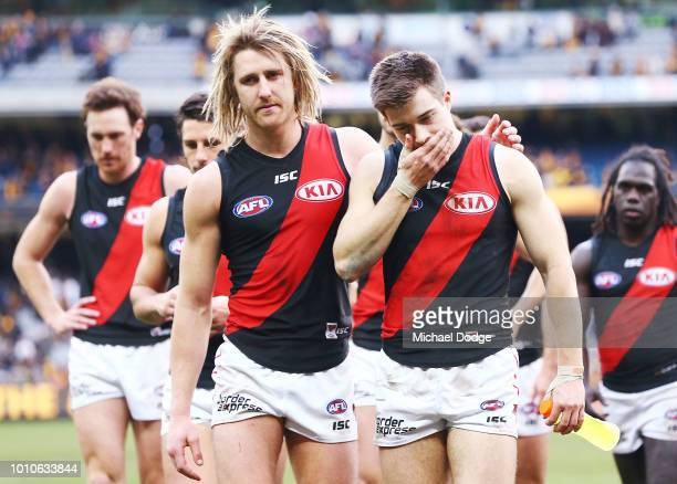 Dyson Heppell and Zach Merrett of the Bombers look dejected after defeat during the round 20 AFL match between the Hawthorn Hawks and the Essendon...