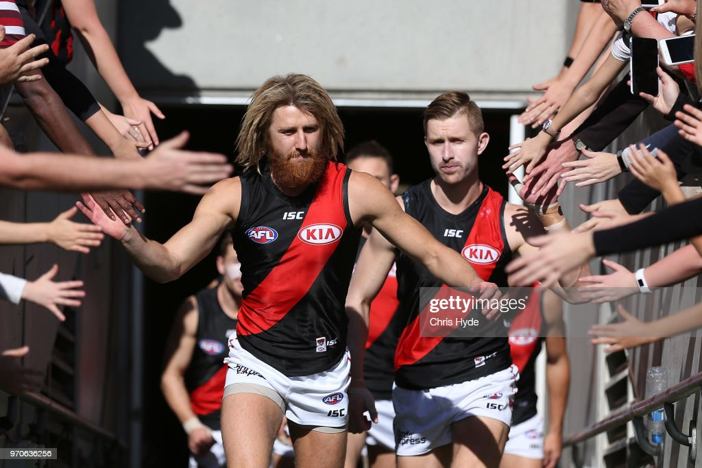 Dyson Heppell leads the Bombers out for the round 12 AFL match between the Brisbane Lions and the Essendon Bombers at The Gabba on June 10, 2018 in Brisbane, Australia.