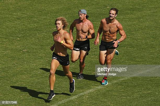 Dyson Heppell leads Travis Colyer who overtakes Jobe Watson in the last of their 1km time trials during a training session at St Bernard's College on...