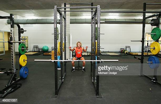 Dyson Heppell lifts weights at the new Essendon Bombers AFL training facility at Tullamarine on November 18 2013 in Melbourne Australia