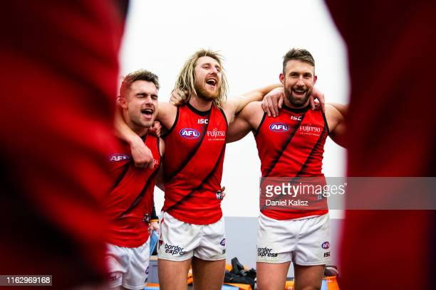 Dyson Heppell of the Bombers and his team mates sing the club songduring the round 18 AFL match between the Adelaide Crows and the Essendon Bombers...
