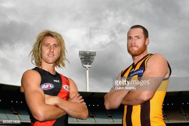 Dyson Heppell of the Bombers and Jarryd Roughead of the Hawks pose during an AFL media opportunity at Melbourne Cricket Ground on March 21 2017 in...