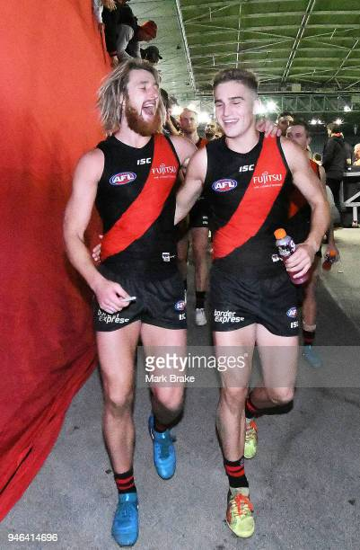 Dyson Heppell of the Bombers celebrates with Matt Guelfi of the Bombers as they head down the race during the round four AFL match between the...