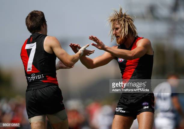 Dyson Heppell of the Bombers congratulates Zach Merrett of the Bombers on a goal during the AFL 2018 JLT Community Series match between the Geelong...