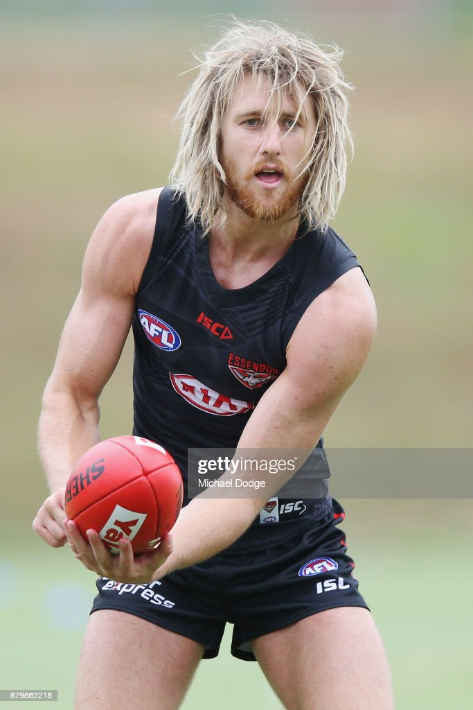 Dyson Heppell of the Bombers handballs during an Essendon Bombers AFL training session at the Essendon Bombers Football Club on November 27, 2017 in Melbourne, Australia.