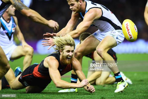 Dyson Heppell of the Bombers handballs during the round four AFL match between the Essendon Bombers and the Port Adelaide Power at Etihad Stadium on...