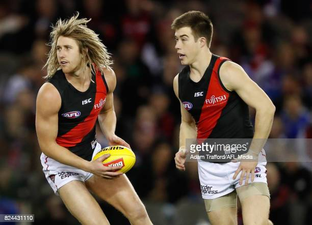 Dyson Heppell of the Bombers in action with Zach Merrett of the Bombers during the 2017 AFL round 19 match between the Western Bulldogs and the...