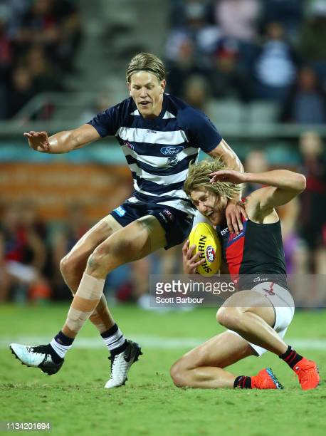 Dyson Heppell of the Bombers is tackled by Rhys Stanley of the Cats during the 2019 JLT Community Series AFL match between the Geelong Cats and the...