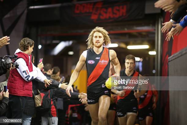 Shaun McKernan of the Bombers leaves the field injured during the round 18 AFL match between the Essendon Bombers and the Fremantle Dockers at Etihad...