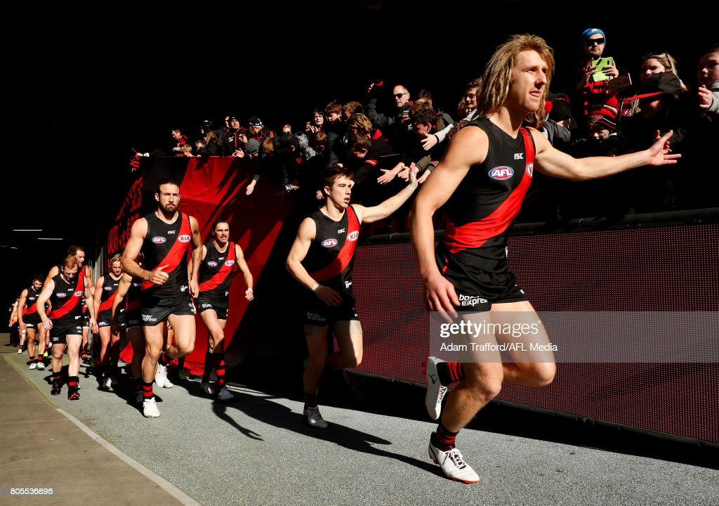 Dyson Heppell of the Bombers leads the team onto the field during the 2017 AFL round 15 match between the Essendon Bombers and the Brisbane Lions at Etihad Stadium on July 02, 2017 in Melbourne, Australia.